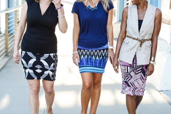 3 women wearing akube skirts